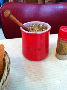 Perhaps the best recycling: ceramic yogurt jar finds a second calling as a mustard-holder.