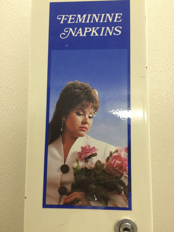 Low-budge Joan Collins + mournful gaze + mullet = feminine protection?