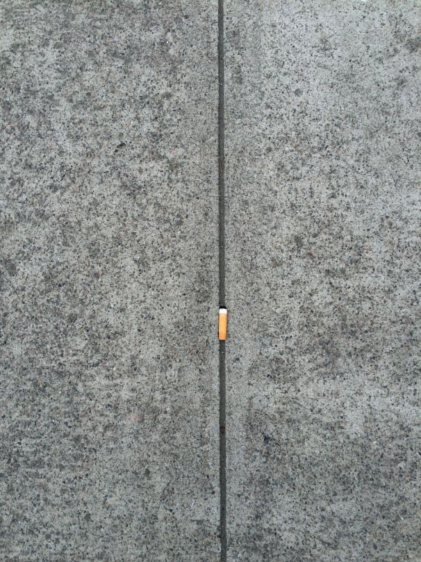 Is that it on a cigarette butt, nestled in between the gray of concrete?