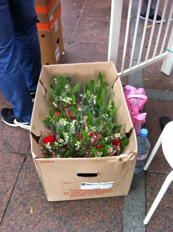 Boxes of flowers, muguet to surely spare.