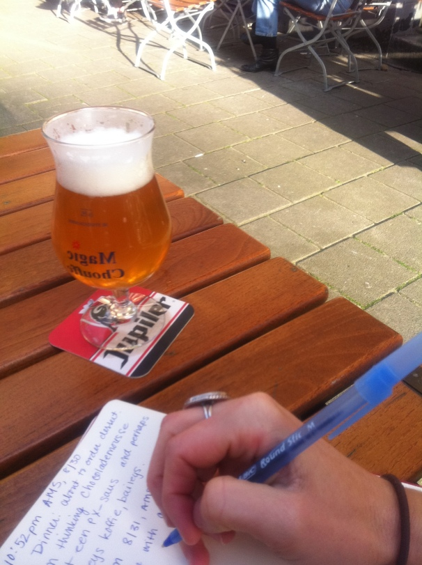 I write in Amsterdam, with beer, wearing a ring I bought on a street in Baltimore for $5.