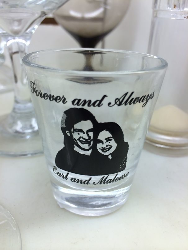 What event inspired the commemorative Shotglass of Love? And why did it end up in a thrift store?